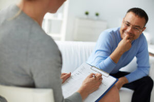 man talks to therapist in outpatient rehab