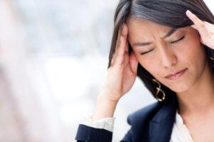 woman with headache fights prescription drug addiction