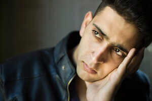 """pensive man wondering """"how long does it take to detox from alcohol?"""""""