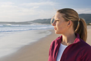 woman gazes out at the ocean - how to detox from drugs