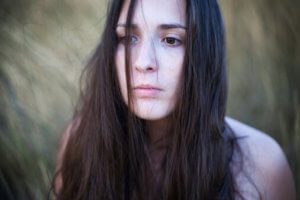 sad looking young woman wonders how to detox from opiates