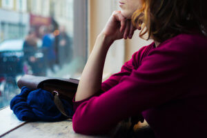 woman contemplates inpatient vs outpatient treatment