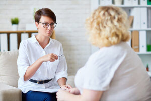 woman talks to psychiatrist in talk therapy