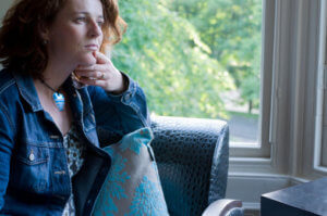 woman contemplates seeking addiction treatment