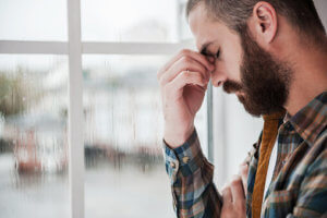 man with headache goes through benzo withdrawal