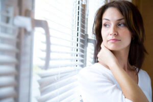 woman gazing out window wonders about United Healthcare drug rehab coverage