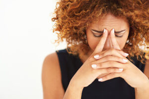 woman with headache needs substance abuse treatment