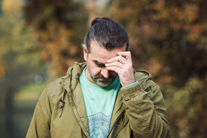 man has headache from using a gateway drug