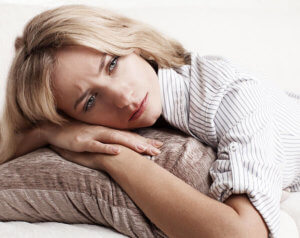 woman laying on pillow wonders how to help an alcoholic