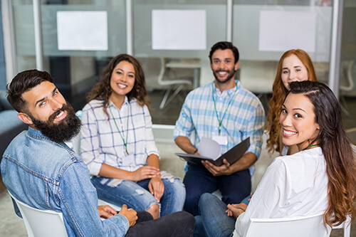 A group of people sit and discuss what is inpatient alcohol rehab