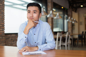 man sitting at coffee shop considers mindfulness training