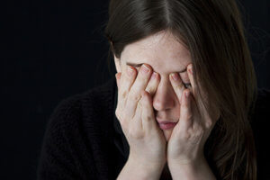 woman with headache suffers from physical dependence