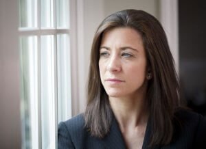 woman looking out window wants to stop drinking alcohol