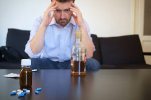 A man appears distressed while regarding common drug interactions