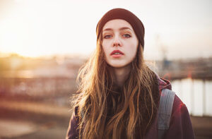 A young woman considers teen drug addiction treatment