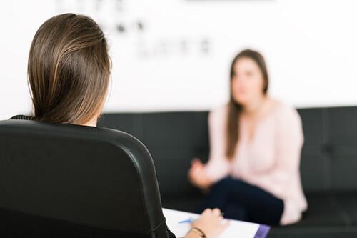 A woman receives drug addiction help