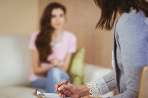 A woman undergoes drug addiction therapy.