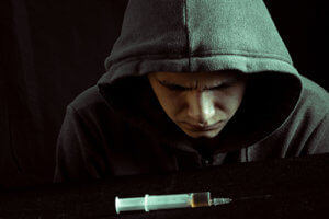 A man struggles with heroin effects