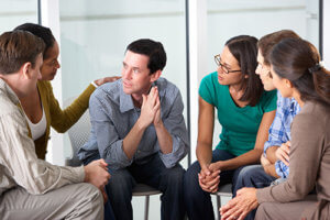 A group discusses rehab facts.