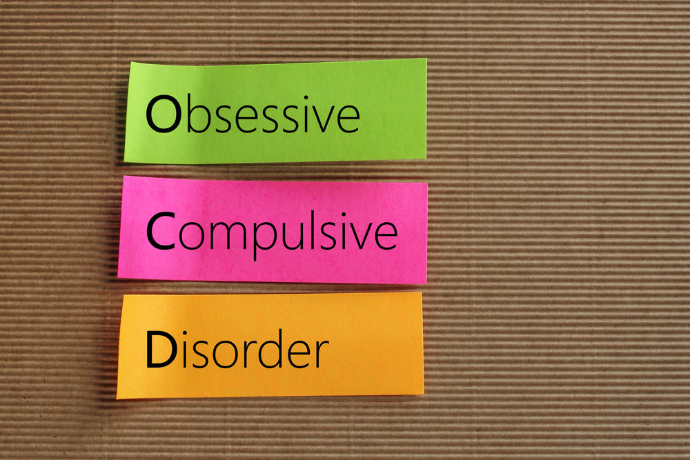 Obsessive Compulsive Disorder (OCD) text on colorful sticky note