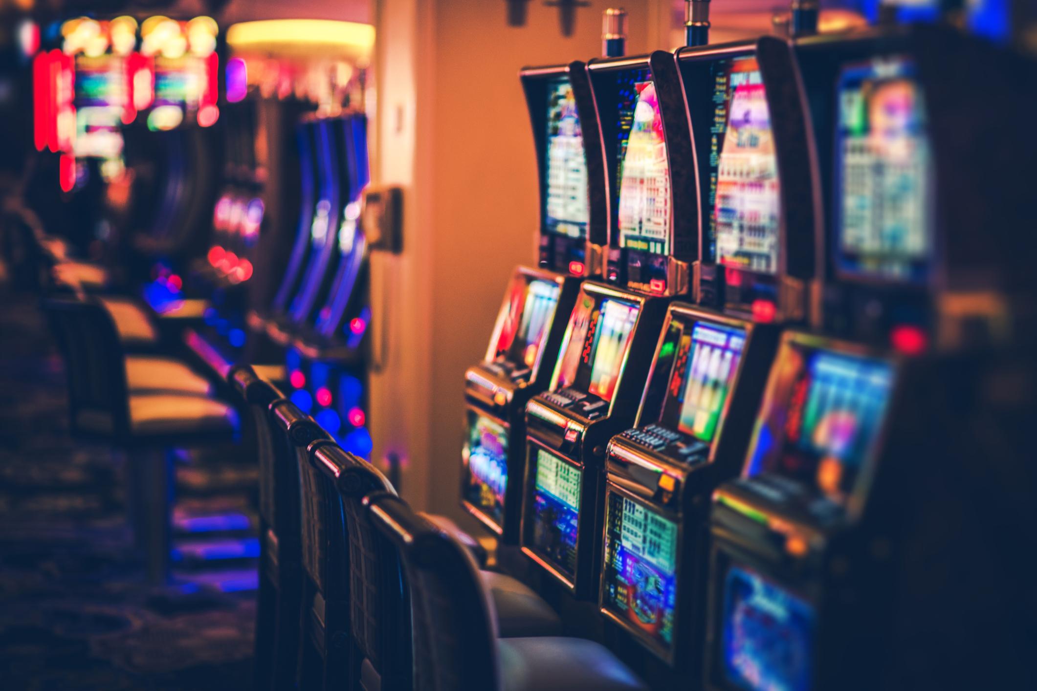 Rows of Casino Slot Machines Representing Gambling Addiction